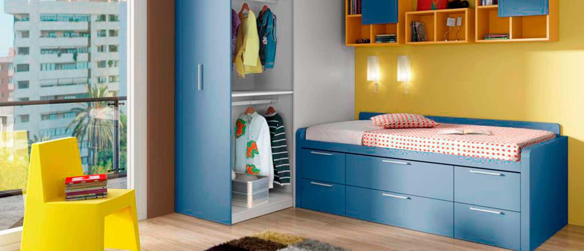 dormitorio infantil azul con cama nido